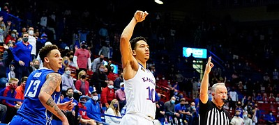 Kansas forward Jalen Wilson (10) watches his three from the wing drop before Creighton forward Christian Bishop (13) during the second half on Tuesday, Dec. 8, 2020 at Allen Fieldhouse.