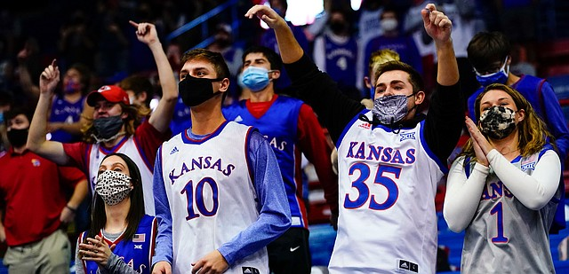 Kansas fans in the student section celebrate a Jayhawk run during the second half on Tuesday, Dec. 8, 2020 at Allen Fieldhouse.