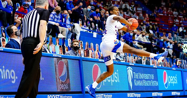 Kansas guard Bryce Thompson (24) saves a ball from going out of bounds during the second half on Tuesday, Dec. 8, 2020 at Allen Fieldhouse.