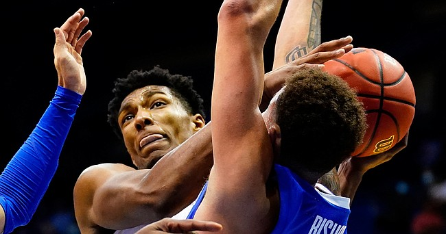 Kansas forward David McCormack (33) tangles for a ball with Creighton forward Christian Bishop (13) during the second half on Tuesday, Dec. 8, 2020 at Allen Fieldhouse.
