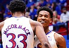 Kansas forward David McCormack (33) throws a chest bump to Kansas guard Ochai Agbaji (30) after a dunk during the second half on Friday, Dec. 11, 2020 at Allen Fieldhouse.