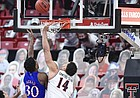Kansas' Ochai Agbaji (30) shoots the winning basket over Texas Tech's Marcus Santos Silva (14) during the second half of an NCAA college basketball game in Lubbock, Texas, Thursday, Dec. 17, 2020. (AP Photo/Justin Rex)