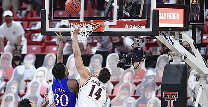Kansas' Ochai Agbaji (30) shoots the winning basket over Texas Tech's Marcus Santos Silva (14) during the second half of an NCAA college basketball game in Lubbock, Texas, Thursday, Dec. 17, 2020. (AP Photo/Justin Rex)