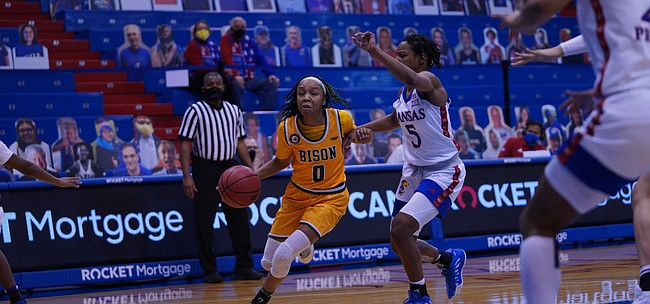 Kansas junior guard Aniya Thomas (5) guards a North Dakota State drive during Monday's game between KU and NDSU at Allen Fieldhouse on Dec. 21, 2020. The Jayhawks dropped a 72-69 decision to the Bison in their first game in 11 days.