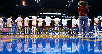 The Jayhawks line up before tipoff against North Dakota State in their second game at Allen Fieldhouse without fans, Saturday, Dec. 5, 2020 at Allen Fieldhouse.