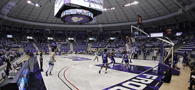 Kansas guard Tristan Enaruna (13) shoots as TCU guards RJ Nembhard (22) and Francisco Farabello (3) watch euring the first half of an NCAA college basketball game in Fort Worth, Texas, Tuesday, Jan. 5, 2021. (AP Photo/Ron Jenkins)