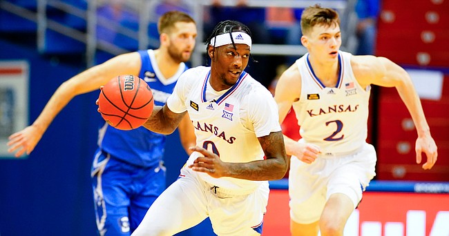 Kansas guard Marcus Garrett (0) heads up the court after a steal during the second half on Tuesday, Dec. 8, 2020 at Allen Fieldhouse.