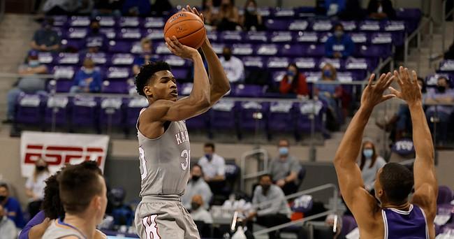 Kansas guard Ochai Agbaji (30) shoots as TCU forward Jaedon LeDee (23) defends during the first half of an NCAA college basketball game in Fort Worth, Texas, Tuesday, Jan. 5, 2021. (AP Photo/Ron Jenkins)