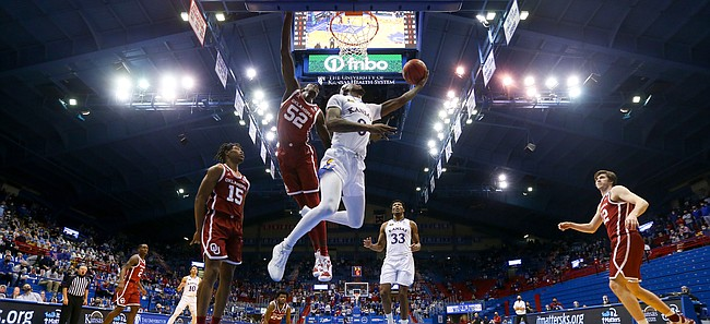 Kansas guard Marcus Garrett (0) floats in for a reverse layup against Oklahoma during the second half, Saturday, Jan. 9, 2021 at Allen Fieldhouse.