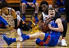 Oklahoma State's Bryce Williams, right rear, and Kansas' Christian Braun scramble for the ball during the first half of an NCAA college basketball game in Stillwater, Okla., Tuesday, Jan. 12, 2021. A jump ball was called. (AP Photo/Mitch Alcala)