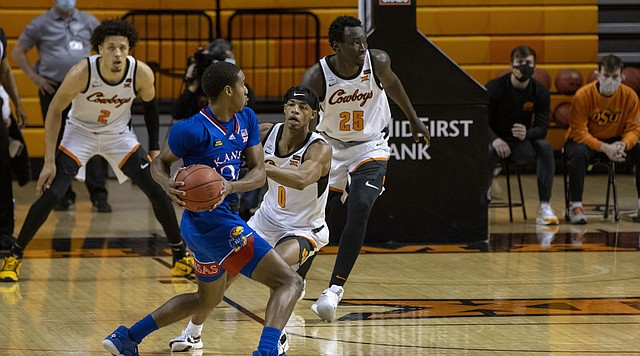Oklahoma State's Avery Anderson III (0) guards Kansas' Bryce Thompson (24) during the second half of the NCAA college basketball game in Stillwater, Okla., Tuesday, Jan. 12, 2021. (AP Photo/Mitch Alcala)