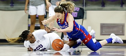 Kansas guard Julie Brosseau dives to the floor after a loose ball against TCU in Schollmaier Arena in Fort Worth, Texas, on Jan. 17, 2021 (Photo/Gregg Ellman )