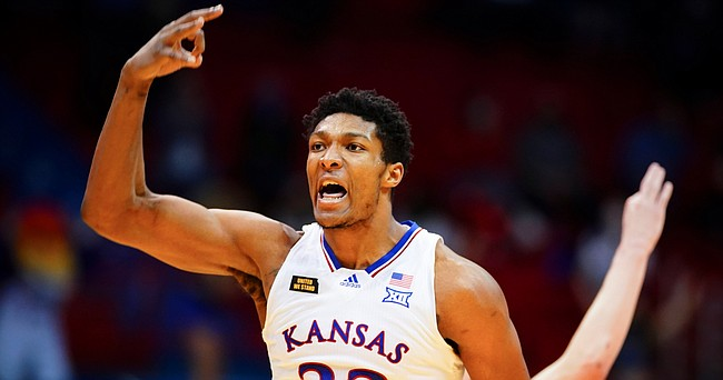 Kansas forward David McCormack (33) celebrates a three-pointer during the second half on Thursday, Jan. 28, 2021 at Allen Fieldhouse.