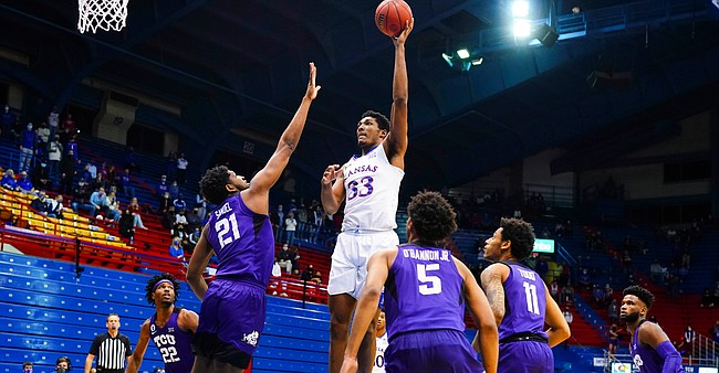 Kansas forward David McCormack (33) turns to put up a shot in the paint over TCU center Kevin Samuel (21) during the first half on Thursday, Jan. 28, 2021 at Allen Fieldhouse.