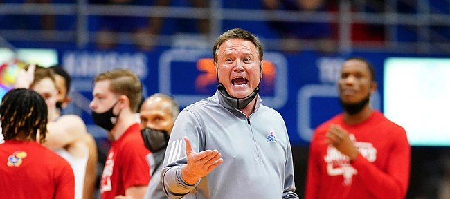 Kansas head coach Bill Self disputes a call with a couple of officials during the first half on Thursday, Jan. 28, 2021 at Allen Fieldhouse.