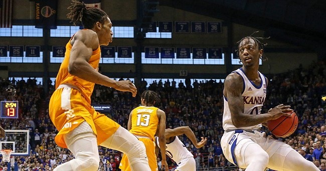 Kansas guard Marcus Garrett (0) looks to make a move against Tennessee guard Yves Pons (35) during the second half, Saturday, Jan. 25, 2019 at Allen Fieldhouse.