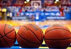 A rack of NCAA basketballs sit inside an empty Allen Fieldhouse before the Jayhawks' game against West Virginia on Dec. 22, 2020.