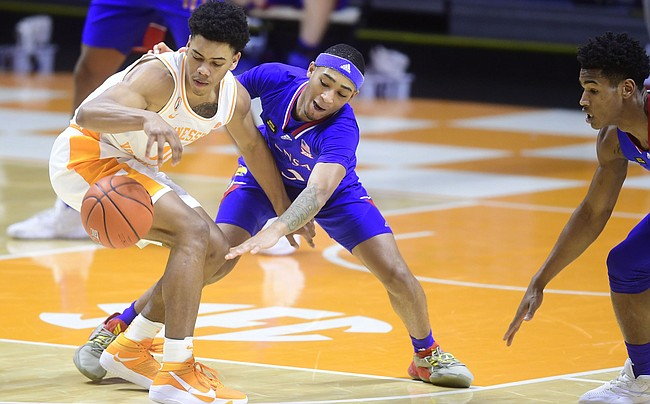 Kansas guard Dajuan Harris Jr. (3) defends against Tennessee guard Jaden Springer (11) during a basketball game between the Tennessee Volunteers and the Kansas Jayhawks at Thompson-Boling Arena in Knoxville, Tennessee on Saturday, January 30, 2021.