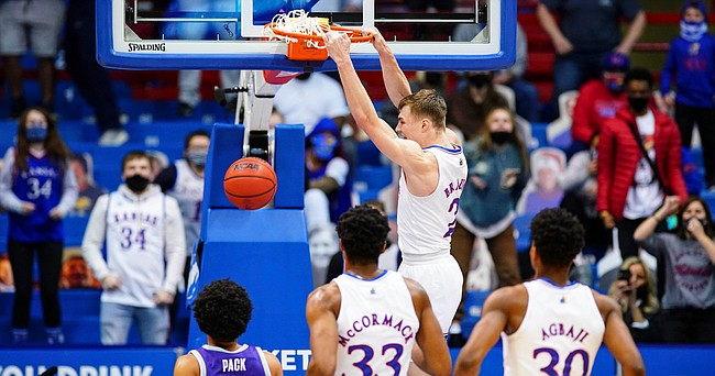 Kansas guard Christian Braun (2) delivers a dunk after a steal during the first half on Tuesday, Feb. 2, 2021 at Allen Fieldhouse.
