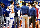 Kansas head coach Bill Self huddles the Jayhawks together during a timeout in the first half on Monday, Feb. 8, 2021 at Allen Fieldhouse.