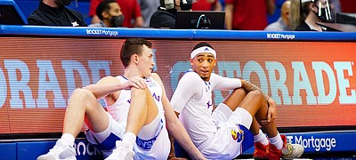 Kansas forward Mitch Lightfoot (44) and Kansas guard Dajuan Harris (3) have a chat while waiting to check in during the second half on Thursday, Jan. 28, 2021 at Allen Fieldhouse.