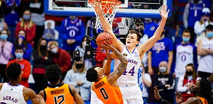 Kansas forward Mitch Lightfoot (44) gets up to block a shot from Oklahoma State guard Avery Anderson III (0) during the first half on Monday, Feb. 8, 2021 at Allen Fieldhouse.