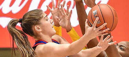 Kansas forward Ioanna Chatzileonti looks to finish at the basket versus a pair of West Virginia defenders on Feb. 10, 2021, at WVU Coliseum.