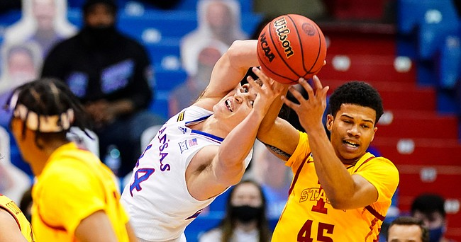 Kansas forward Mitch Lightfoot (44) fights for a ball with Iowa State guard Rasir Bolton (45) during the first half on Thursday, Feb. 11, 2021 at Allen Fieldhouse.