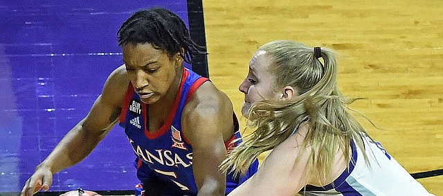 Kansas guard Aniya Thomas battles for the ball in the Jayhawks' loss at Kansas State on Feb. 13, 2021.