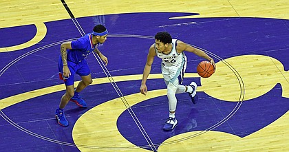 Kansas guard Dajuan Harris defends the ball during a game against K-State at Bramlage Coliseum in Manhattan, Kansas on February 17, 2021.