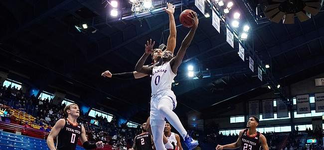Kansas guard Marcus Garrett (0) shoots against Texas Tech guard Kevin McCullar (15) during the first half at Allen Fieldhouse Saturday afternoon in Allen Fieldhouse on Feb. 20, 2021. Photo by Jay Biggerstaff-USA TODAY Sports.