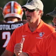 Jake Schoonover was hired by Les Miles to become the Kansas football team's outside linebackers coach and special teams coordinator. Schoonover worked previously at Bowling Green.