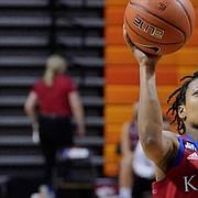 Kansas guard Aniya Thomas (5) shoots in front of Oklahoma State forward Natasha Mack (4) in the first half of an NCAA college basketball game Tuesday, Feb. 2, 2021, in Stillwater, Okla. (AP Photo/Sue Ogrocki)