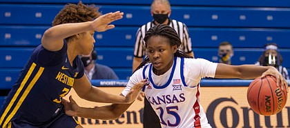 Kansas guard Zakiyah Franklin attacks off the dribble against West Virginia during the Jayhawks' home game on Feb. 27, 2021.