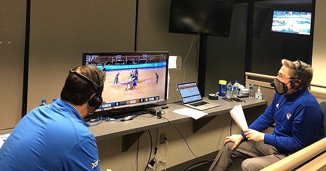 Stationed inside the radio booth at Memorial Stadium, Kansas basketball broadcasters Brian Hanni, right, and Greg Gurley await the opening tip of the Jayhawks' 75-72, overtime loss to Texas on Feb. 23, 2021 in Austin, Texas.