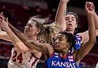 Kansas guard Aniya Thomas battles for a rebound against Iowa State on March 3, 2021, at Hilton Coliseum, in Ames, Iowa.
