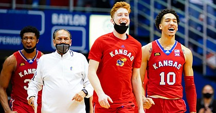 The Kansas bench empties to celebrate during a timeout in the second half on Saturday, Feb. 27, 2021 at Allen Fieldhouse.