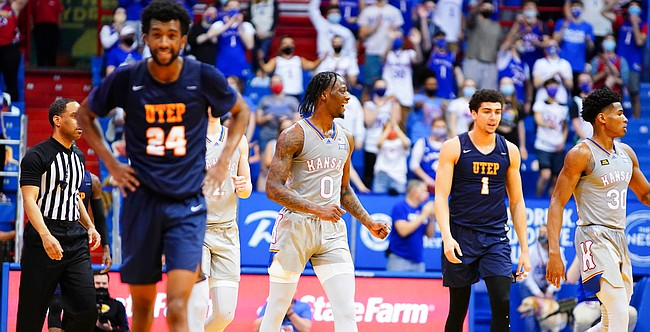 Kansas guard Marcus Garrett (0) clenches his fist after the Jayhawks' pulled off a 67-62 comeback win over UTEP on Thursday, March 4, 2021 at Allen Fieldhouse.