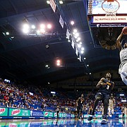 Kansas guard Ochai Agbaji (30) soars in for a breakaway dunk against UTEP guard Keonte Kennedy (3) during the second half on Thursday, March 4, 2021 at Allen Fieldhouse.