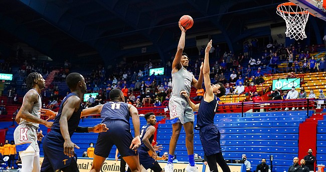Kansas forward David McCormack (33) turns for a shot in the paint and a foul from UTEP forward Tydus Verhoeven (1) during the second half on Thursday, March 4, 2021 at Allen Fieldhouse.
