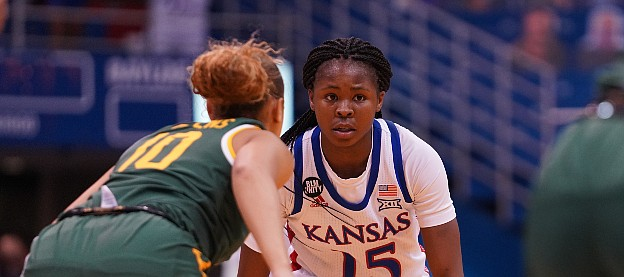 Kansas guard Zakiyah Franklin surveys the floor from the top of the key against Baylor on March 6, 2021, inside Allen Fieldhouse.