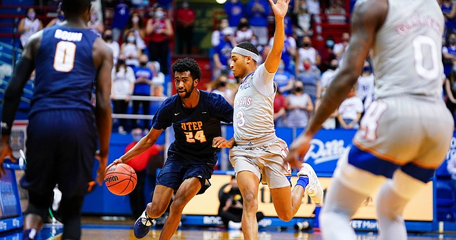 Kansas guard Dajuan Harris (3) pressures UTEP guard Jamal Bieniemy (24) as he drives the ball up the court during the first half on Thursday, March 4, 2021 at Allen Fieldhouse.