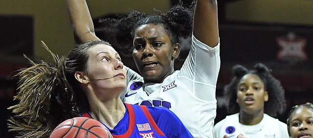 Kansas guard Holly Kersgieter tries to find some space inside versus TCU during the Phillips 66 Big 12 Women's Basketball Championship at Municipal Auditorium in Kansas City, Missouri on March 11, 2021.