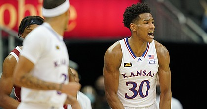 KU junior Ochai Agbaji flexes after a big bucket during KU's 69-62 win over No. 25 Oklahoma in the quarterfinals of the Big 12 tournament on Thursday, March 11, 2021 at T-Mobile Center in Kansas City, Mo.