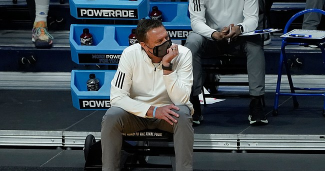 Kansas head coach Bill Self watches from the bench against USC during the second half of a men's college basketball game in the second round of the NCAA tournament at Hinkle Fieldhouse in Indianapolis, Monday, March 22, 2021. (AP Photo/Paul Sancya)
