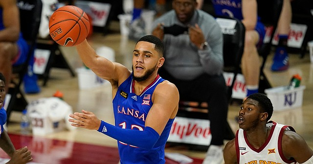 Kansas guard Tristan Enaruna passes in front of Iowa State guard Jalen Coleman-Lands, right, during the first half of an NCAA college basketball game, Saturday, Feb. 13, 2021, in Ames, Iowa. (AP Photo/Charlie Neibergall)
