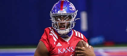 Kansas quarterback Jalon Daniels runs the ball during the Jayhawks' first spring practice, on March 30, 2021.