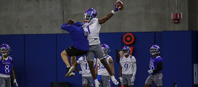 Kansas safety Kenny Logan Jr. celebrates after making a play during the Jayhawks' first spring football practice, on March 30, 2021.