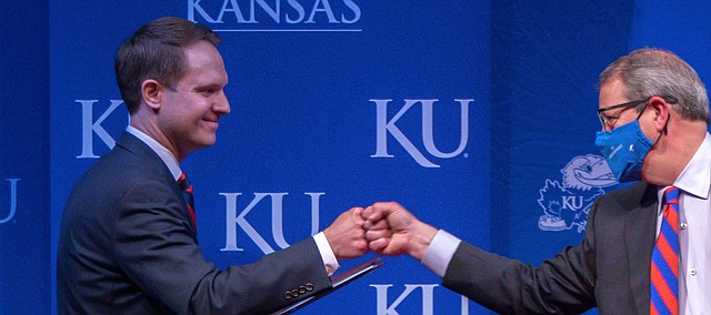 Travis Goff, a 2002 graduate of the University of Kansas and native of Dodge City, left, fist-bumps KU Chancellor Douglas Girod, right, on Wednesday, April 7, 2021, at the Lied Center on KU's west campus.
