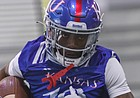 Kansas receiver Steven McBride runs through a drill during a spring practice at the Jayhawks' indoor facility on March 30, 2021.